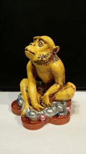 sitting monkey wealth feng shui